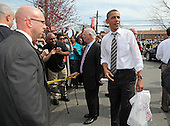 United States President Barack Obama and U.S. Senator Ben Cardin (Democrat of Maryland) greet bystanders following a stop for carry-out at Texas Ribs & BBQ in Clinton, Maryland, Thursday, March 15, 2012. The president stopped by to pick up some ribs following his speech on American energy at Prince George's Community College..Credit: Martin Simon / Pool via CNP