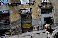 An old Cuban woman passes in front of the ruins of a collapsed house in the Old Havana, Cuba, 13 August 2008. About 50 years after the national rebellion, led by Fidel Castro, and adopting the communist ideology shortly after the victory, the Caribbean island of Cuba is the only country in Americas having the communist political system. Although the Cuban state-controlled economy has never been developed enough to allow Cubans living in social conditions similar to the US or to Europe, mostly middle-age and older Cubans still support the Castro Brothers' regime and the idea of the Cuban Revolution. Since the 1990s Cuba struggles with chronic economic crisis and mainly young Cubans call for the economic changes.