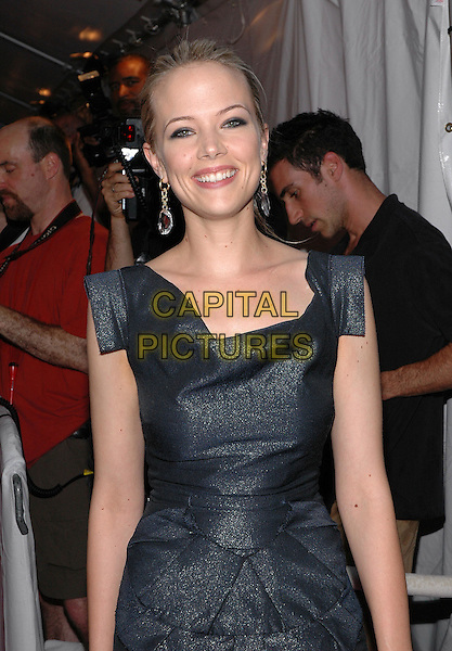 """PELL JAMES.The premiere of her new film, """"Broken Flowers"""", at the Chelsea West Cinema in Manhattan, New York, New York.  .July 27th, 2005.Photo Credit: Patti Ouderkirk/AdMedia.half length grey gray dress  .www.capitalpictures.com.sales@capitalpictures.com.© Capital Pictures."""