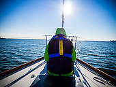 Environmental educator and author Jennifer Chambers rides on the bow of the Obtuse as it heads out to Chesapeake Bay. Chambers is part of an expedition to collect water and sediment samples. The samples will be sent to Florida Atlantic University for analysis. The data will be used to quantify the health of the Chesapeake Bay water way. The expedition was organized by Trash Free Maryland and brings together plastic pollution experts, educators, environmentalists, policy advocates and journalists. <br /> <br /> PHOTOS/John Nelson