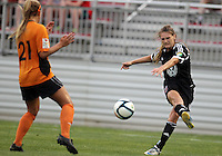 BOYDS, MARYLAND-JULY 07,2012:  Ashley Herndon (15) of DC United Women blasts a shot past Lauren Hettinger (21) of Dayton Dutch Lions during a W League game at Maryland Soccerplex, in Boyds, Maryland. DC United women won 4-1.