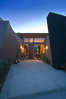 night time exterior of ultra modern architecture home in the California desert