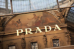 Prada brand name reflected in window in Vittorio Emanuele II Shopping Gallery; Milan, Italy