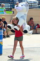 A girl gives a piggy back ride to her prize along Ocean Front Walk on Sunday, July 1, 2012..