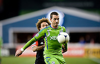 Nick DeLeon (18) of D.C. United applies pressure to Zach Scott (20) of the Seattle Sounders during the game at RFK Stadium in Washington DC.   D.C. United tied  the Seattle Sounders, 0-0.