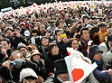 December 23, 2011, Tokyo, Japan - Well-wishers wave Japanese national flags to celebrate Japan's Emperor Akihito's 78th birthday at the Imperial Palace in Tokyo on Friday, December 23, 2011. (Photo by Natsuki Sakai/AFLO)