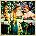 An image of 3 women in National folklore costumes of Kyjov in Slovakia found on a flea market. Belgium, 2012