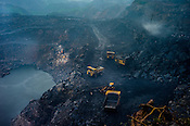 Trucks dig out coal from open cast mine, Ghanudih in Jharia, outside of Dhanbad in Jharkhand, India.  Photo: Sanjit Das/Panos