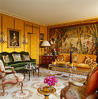 The drawing room is dominated by a bold Aubusson tapestry and is filled with furniture and objects that span the centuries