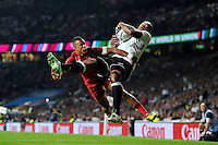 Nemani Nadolo of Fiji claims the ball in the air to score a try, despite the challenge of Anthony Watson of England. Rugby World Cup Pool A match between England and Fiji on September 18, 2015 at Twickenham Stadium in London, England. Photo by: Patrick Khachfe / Onside Images