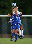 11 October 2007: North Carolina's Yael Averbuch (center) outjumps Duke's CJ Ludemann (10) and Jane Alukonis (5) and teammate Allie Long (behind) and heads the ball. The University of North Carolina Tar Heels defeated the Duke University Blue Devils 2-1 at Fetzer Field in Chapel Hill, North Carolina in an Atlantic Coast Conference NCAA Division I Women's Soccer game.