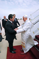 """King Abdullah II of Jordan, left, receives Pope Benedict XVI on his arrival in Amman, Jordan, Friday, May, 8, 2009. Pope Benedict XVI begins a week long tour in the Middle East on Friday that includes Jordan and Israel, and the Palestinian territories. In his first visit as pope to an Arab country, Benedict will meet with Muslim religious leaders at Amman's largest mosque. A self-described """"pilgrim of peace"""" seeking to strengthen frayed ties with Muslims and Jews and give support to his beleaguered Christian flock in the region"""