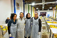 Roma 24 Dicembre 2012..Mensa per i poveri allla Cittadella della carità Santa Giacinta ( Via Casilina Vecchia, 19), i volontari della Caritas che  servono la cena la sera di Natale.