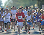 Runners take off at the starting line at the Stars and Stripes 5K in Oxford, Miss. on Monday, July 4, 2011.