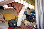 RENO, NV - OCTOBER 6:  Bob Taylor packs up his possessions in a tent city for the homeless in downtown Reno, Nevada October 6, 2008. The City of Reno set up the tent city when existing shelters became overcrowded as Nevada struggles with one of the highest unemployment rates in the country. Today, Reno is evicting all male residents of the tent city, and housing them in a shelter in the nearby city of Sparks.(Photo by Max Whittaker/Getty Images)