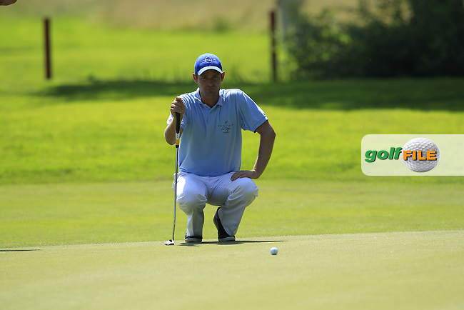 Christoph Gunther (GER) lines up his putt on the 5th green during Thursday's Round 1 of the 2013 BMW International Open held on the Eichenried Golf Club, Munich, Germany. 20th June 2013<br /> (Picture: Eoin Clarke www.golffile.ie)