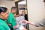 President and First Lady McDavis help students move into their room in Biddle Hall. Photo by Ben Siegel