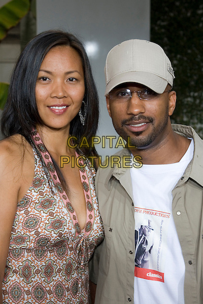 """TIM STORY & GUEST.At the """"Hustle & Flow"""" Los Angeles Film Premiere,.held at the Arclight Cinerama Dome, .Hollywood, California, USA, 20th July 2005..portrait headshot cap hat.Ref: ADM.www.capitalpictures.com.sales@capitalpictures.com.©Zach Lipp/AdMedia/Capital Pictures."""
