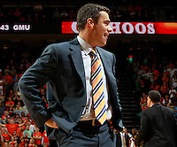CHARLOTTESVILLE, VA- DECEMBER 6: Head coach Tony Bennett of the Virginia Cavaliers reacts to a call during the game on December 6, 2011 against the George Mason Patriots at the John Paul Jones Arena in Charlottesville, Virginia. Virginia defeated George Mason 68-48. (Photo by Andrew Shurtleff/Getty Images) *** Local Caption *** Tony Bennett