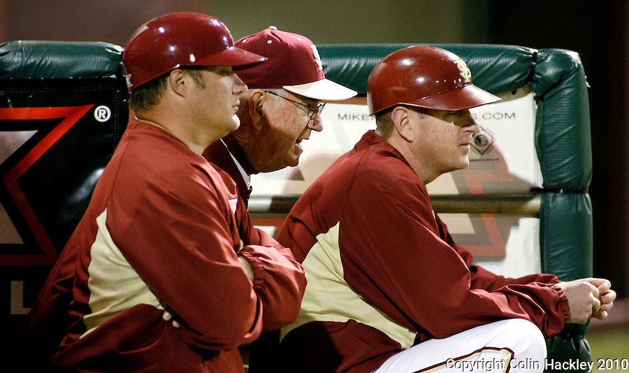 TALLAHASSEE, FL 10-FSU-GA.ST. BASE10 CH27-Florida State Head Coach Mike Martin, center, talks with Brian Hoop, volunteer coach, left, and Mike Martin, Jr. during action against Georgia State Friday at Dick Howser Stadium in Tallahassee. The Seminoles beat the Panthers 11-3 in the 2010 season opener...COLIN HACKLEY PHOTO