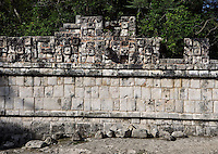 Chaac, God of the rain, Symbol of corn (¤) above the mask of Chaac, Palace of the sculptured columns, East Side of the Upper Façade, 1100-1300 AD, Puuc Architecture, Chichen Itza, Yucatan, Mexico. Picture by Manuel Cohen