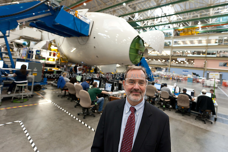 9/19/2011--Everett, WA, USA..Mike Sinnett, 787 vice president and chief project engineer, on the factory floor with Boeing's 787 Dreamliner behind. Boeing will deliver the first 787 tolaunch customer ANA (All Nippon Airways) at the end of the month...©2011 Stuart Isett. All rights reserved.