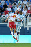 Midfielders Teemu Tainio (2) Red Bulls and Julio Cesar (55) Red Bulls go up for a header...Sporting Kansas City defeated New York Red Bulls 2-0 at LIVESTRONG Sporting Park, Kansas City, Kansas.