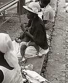 A mother nurses her baby while waiting to be seen at the Albert Schweitzer hospital compound. photo by jane therese