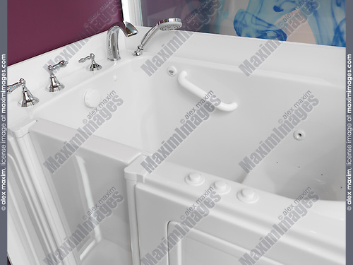 Accessible bathroom. Sitting shower bath tub with a door for people with disabilities.