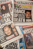 The covers of local New York newspapers report on the arrest of alleged serial killer and clothing salesman Salvatore Perrone who allegedly murdered three shopkeepers whom he sold clothing to.  (© Richard B. Levine)