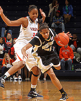 Feb. 3, 2011; Charlottesville, VA, USA; Wake Forest Demon Deacons forward Brittany Waters (20) drives past Virginia Cavaliers forward Telia McCall (30) during the game at the John Paul Jones Arena.  Mandatory Credit: Andrew Shurtleff