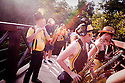 Minor Mishap Marching Band, a renegade group of street musicians in Austin, Texas, plays a surprise concert on Barton Creek.
