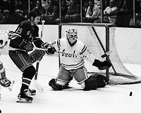 "Seals vs New York Rangers..Rangers Jean Ratelle and Seals goalie Gary ""The Cobra"" Simmons. (1974 photo/Ron Riesterer)"