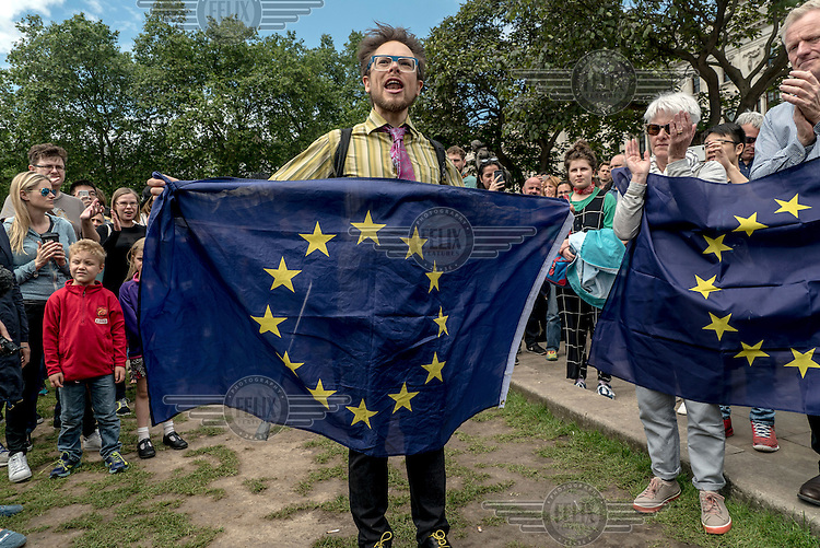 People in Parliament Square holding EU flags at a demonstration against the victory of the 'leave' (the EU) side in the EU reeferendum.