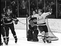 Seals Stan Gilbertson scores against the LA Kings goalie Rogie Vachon.  (1971 photo by Rpm Riesterer)