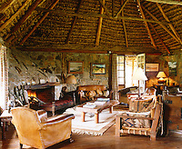 This living area is a mixture of natural elements;  a roof of thatched coconut palm leaves and local rocks and boulders for the walls