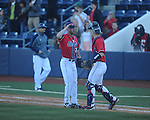 Ole Miss' Brett Huber (38) and catcher Stuart Turner (26) celebrate vs. Rhode Island at Oxford-University Stadium in Oxford, Miss. on Sunday, February 24, 2013. Ole Miss won 5-3 to improve to 7-0.