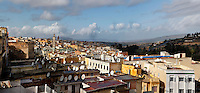 Panoramic view, Meknes, Morocco pictured on December 22, 2009. The rooftops look out over the hilly landscape, many of them with satellite dishes. Meknes, one of Morocco's Imperial cities, was redeveloped under Sultan Ismail Moulay (1634-1727). It is a fortified city built from pise, or clay and straw, and was designed to be the political capital of Morocco, as opposed to Fez, the religious capital. Picture by Manuel Cohen