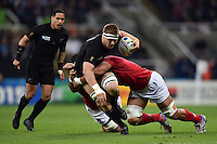 Sam Cane of New Zealand is tackled in possession. Rugby World Cup Pool C match between New Zealand and Tonga on October 9, 2015 at St James' Park in Newcastle, England. Photo by: Patrick Khachfe / Onside Images