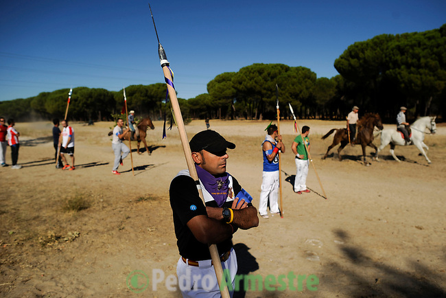 A man with a lance walks to his position on the plain as he awaits the arrival of the bull during the 'El toro de la Vega' (The bull of the plain) bullfight, 17 September 2013 in Tordesillas, near Valladolid. The festival is one of the oldest in Spain with roots dating back to the fifteenth century. The bull has to be enticed across the river from the village to the plain 'Vega' before it can be killed to honour the 'Virgen de la Pena'. (c) Pedro ARMESTRE