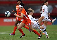 COLLEGE PARK, MD - OCTOBER 28, 2012:  Erika Nelson (15) of the University of Maryland is knocked over by Ally Andreini (27) of Miami during an ACC  women's tournament 1st. round match at Ludwig Field in College Park, MD. on October 28. Maryland won 2-1 on a golden goal in extra time.