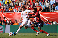 Xabi Alonso (14) of Spain is marked by Maurice Edu (7) of the United States. The men's national team of Spain (ESP) defeated the United States (USA) 4-0 during a International friendly at Gillette Stadium in Foxborough, MA, on June 04, 2011.