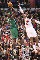 12/27/12 Los Angeles, CA: Boston Celtics power forward Kevin Garnett #5 and Los Angeles Clippers center Ronny Turiaf #21 during an NBA game between the Los Angeles Clippers and the Boston Celtics played at Staples Center. The Clippers defeated the Celtics 106-77 for their 15th straight win.