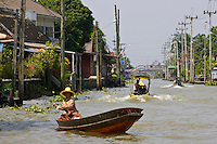 Woman in a boat, Bangkok, Thailand