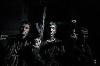 In this Thursday, Oct. 25, 2012 photo. Rebel fighters belonging to the Liwa Al Tawhid pose for photo at the Karmal Jabl battlefield after several days of intense clashes between rebel fighters and the Syrian army in Aleppo City. (AP Photo/Narciso Contreras).