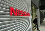 ******FOR MAGAZINE*******.An employee exits Nissan Motor Co.'s headquarters in Yokohama, Japan on Monday 19 Oct.  2009. .Photographer: Robert Gilhooly/Bloomberg News