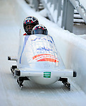 18 December 2010: Helen Upperton crosses the finish line, finishing in 3rd place for Canada at the Viessmann FIBT World Cup Bobsled Championships on Mount Van Hoevenberg in Lake Placid, New York, USA. Mandatory Credit: Ed Wolfstein Photo