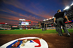 28 September 2010: The sky dims as the game officials take to the field prior to a game between the Washington Nationals and the Philadelphia Phillies at Nationals Park in Washington, DC. The Nationals defeated the Phillies 2-1 on an Adam Dunn walk-off solo homer in the 9th inning to even up their 3-game series one game apiece. Mandatory Credit: Ed Wolfstein Photo