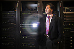 Vivek Sarkar stands next to an IBM supercomputer