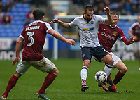 Bolton Wanderers' Filipe Morais holds off the challenge from Northampton Town's Matthew Taylor<br /> <br /> Photographer Alex Dodd/CameraSport<br /> <br /> The EFL Sky Bet League One - Bolton Wanderers v Northampton Town - Saturday 18th March 2017 - Macron Stadium - Bolton<br /> <br /> World Copyright &copy; 2017 CameraSport. All rights reserved. 43 Linden Ave. Countesthorpe. Leicester. England. LE8 5PG - Tel: +44 (0) 116 277 4147 - admin@camerasport.com - www.camerasport.com